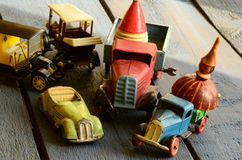 Set of vintage toys - convertible toy car, trucks (lorries) toy, post car toy and spinning (humming) tops Royalty Free Stock Images