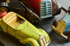 Set of vintage toys - convertible toy car, trucks (lorries) toy, post car toy and spinning (humming) tops Royalty Free Stock Image