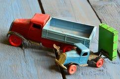Set of vintage toys - trucks (lorries) toys on blue wooden background Stock Photos