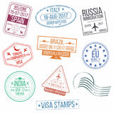 Set of visa passport stamps. International arrivals sign rubber stamps. Stock Photos