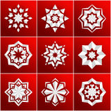 Set of volumetric white snowflake on a red background. Christmas star. Mandala. Royalty Free Stock Photo