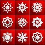 Set of volumetric white snowflake on a red background. Christmas star. Mandala. Set of volumetric white snowflake on a red background. The bulk of the star Royalty Free Stock Photo