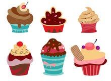 Set von sechs netten kleinen Kuchen. Stockbild