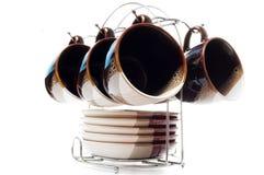 Set von sechs Teacups und von Tellern Stockfotografie