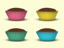 Set von vier kleinen Kuchen Lizenzfreie Stockfotografie