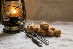 Set with walnuts, a nutcracker and a lantern Royalty Free Stock Photo
