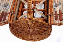 Set of ware for picnic. Set for picnic in a basket. Consists of four plates, four glasses, four spoons, four plugs and four knifes Royalty Free Stock Photo
