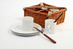 Set of ware for picnic. Set for picnic in a basket. Consists of four plates, four glasses, four spoons, four plugs and four knifes Royalty Free Stock Images