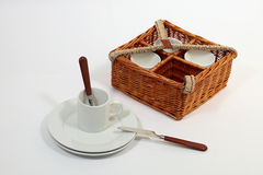 Set of ware for picnic. Set for picnic in a basket. Consists of four plates, four glasses, four spoons, four plugs and four knifes Stock Images