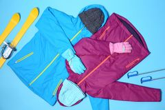 Set of warm sports clothes on color background, flat lay. royalty free stock image
