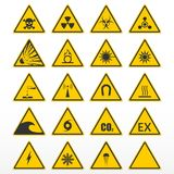 Set of warning signs. Yellow triangles as hazard symbols. Vector illustration Stock Image
