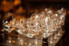 Set of washed and clean empty cocktail glasses Stock Photos