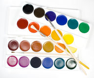 Set of water colour paints. With paintbrushs royalty free stock photos