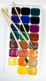 Set of water colour paints. With paintbrushes stock photography