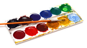 Set of water-colour paints and brush Royalty Free Stock Photography