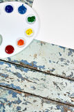 Set of watercolor aquarell rainbow paints and brushes on vintage Royalty Free Stock Image