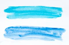 Set of watercolor brush strokes of blue and azure paint on white royalty free stock photo