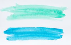 Set of watercolor brush strokes of blue and azure paint on white royalty free stock image