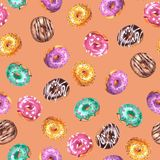 Set of watercolor hand drawn sketch illustration of colorful glazed donuts isolated on  peach pink color  background. Seamless. Set of watercolor hand drawn stock illustration