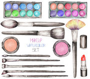 A set with the watercolor makeup tools:  blusher, eyeshadow, lipstick and makeup brushes Stock Image