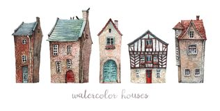 A set of watercolor old houses. A set of watercolor illustrations of old European houses with wooden doors, tile roofs and flowers on the windowsills vector illustration
