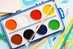 Set of watercolor paints in a box with paintbrush stock images