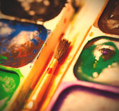 Set of watercolor paints with brush Royalty Free Stock Image