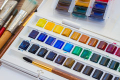 Set of watercolor paints with brushes. Close up royalty free stock images