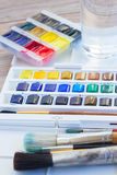 Set of watercolor paints with brushes Royalty Free Stock Photos