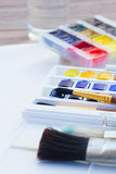 Set of watercolor paints with brushes Stock Photo