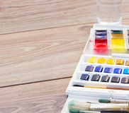 Set of watercolor paints with brushes Royalty Free Stock Image