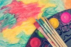 Set of watercolor paints and brushes Royalty Free Stock Images