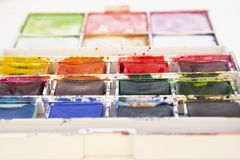 Set of watercolor paints isolated for painting closeup. Selective focus. Art, creative background with copy space. Design abstract colors work texture school royalty free stock images