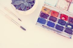 Set of watercolor paints isolated for painting closeup. Selective focus. Art, creative background with copy space. Design abstract colors work texture school stock photography
