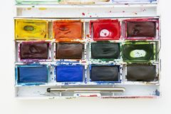 Set of watercolor paints isolated for painting closeup. Selective focus. Art, creative background with copy space. Design abstract colors work texture school stock photos
