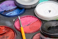 Set of watercolor paints and paintbrush. For painting closeup. Aquarelle paints Royalty Free Stock Photo