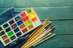 Set of watercolor paints. And paintbrushes for painting stock photos