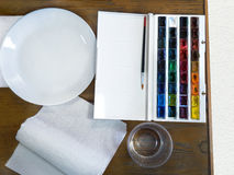 Set of watercolor paints ready for painting. Top view. Stock Image