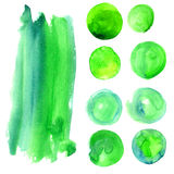 Set of watercolor stains of greenery color. Stock Photos