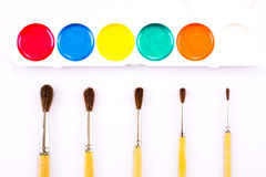 Set of watercolour paints and paintbrushes Royalty Free Stock Images