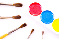 Set of watercolour paints and paintbrushes Stock Image