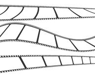 Set of waved film or camera strips on white background.  Royalty Free Stock Photo