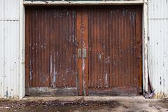 A set of weathered shed barn doors with faded paint as an abstra Stock Photography