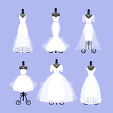 Set of Wedding Dresses. Fashion gowns on mannequins. White dresses in Different styles. Vector Royalty Free Stock Images
