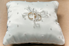 Set of wedding rings. Tied to a white lace pillow Stock Images