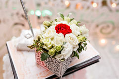 Set of wedding rings in Red and white rose taken closeup. wedding concept. selective focus. flower arrangement box for Stock Image