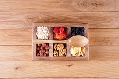 Set for weight loss. Dried fruits, nuts, oat flakes, corn flakes. Wooden background Royalty Free Stock Images
