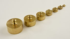 Set of weights made from brass Stock Photos