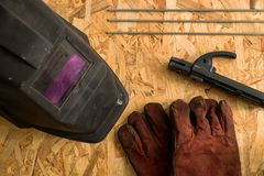 Set of welder tools on wood background . flat lay tools working stock images