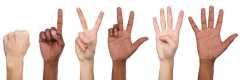 Set of black and white man`s hands. Male hands show figures, counting. Set of white and african-american male hand show figures, count one, two, three, four stock photo